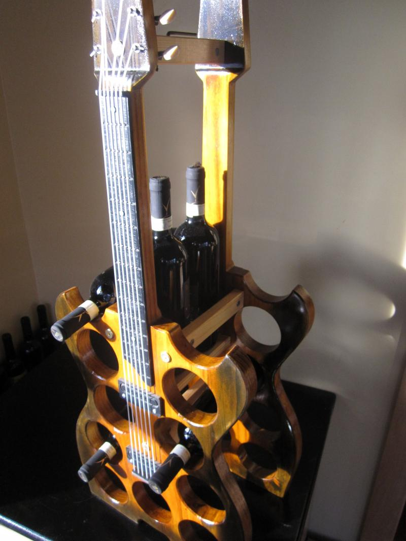 13 bottle guitar wine rack looks so real, you might try to play it!